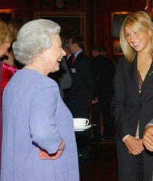 The Queen enjoying a cup of tea at a reception for the World Cup Winning Team at Buckingham Palace