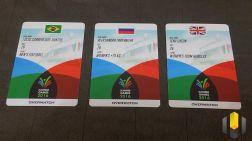 Cards dos personagens Lucio, Zarya e Tracer, cada um representando seu país em um esporte diferente
