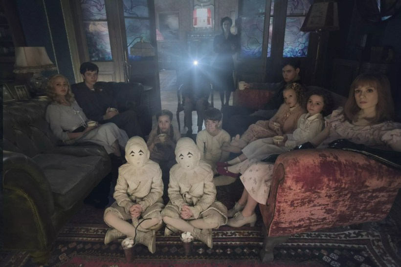 DF-02825modified - Seated on the floor: the twins (Thomas and Joseph Odwell), Fiona (Georgia Pemberton) and Hugh (Milo Parker), Left to right: Emma (Ella Purnell), Jake (Asa Butterfield), Horace (Hayden Keeler-Stone), Miss Peregrine (Eva Green), Enoch (Finlay Macmillan), Claire (Raffiella Chapman), Bronwyn (Pixie Davies) and Olive (Lauren McCrostie) - are the very special residents of MISS PEREGRINE'S HOME FOR PECULIAR CHILDREN. Photo Credit: Leah Gallo.