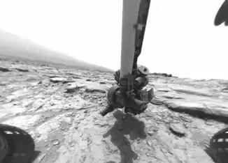 Jipe-sonda Curiosity trabalhando.