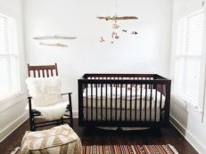 """""""For Elijah's nursery, we went with the smallest room in the house. This room is cozy and warm and has such soft light with a straight shot view of a giant Juniper tree just outside the window. Because the walls were white, I wanted the things in this room to be colorful and interesting to look at. There is no theme, simply things we love; handmade, hand me downs, items collected from travels & items that we already had in the home. The room is just the right balance of peaceful and playful."""""""