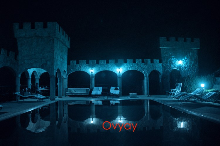 Steel pool at Kajuru Castle at night.