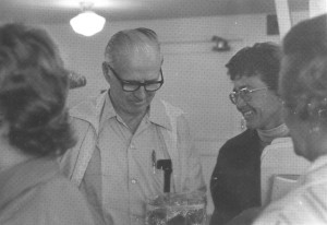 1977 Dr. Borlaug (left) admiring a gift of freshly-picked Oregon raspberries, presented by Ms. Eunice Endicott of Eugene (in the foreground, right.) In the middle is Liz VanLeeuwen OWA president 1973-1975