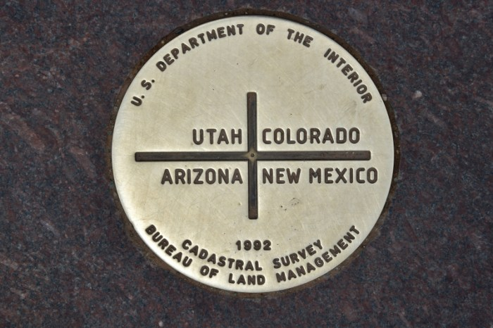 A view of the metal disc representing the State Line Survey marker showing the exact meeting point of the US states of Colorado, New Mexico, Arizona and Utah at the Four Corners Monument, taken on May 15, 2015. The Four Corners is the only location in the US where the boundaries of four states - Colorado, New Mexico, Arizona and Utah - meet at a right angle. AFP PHOTO / MLADEN ANTONOV (Photo credit should read MLADEN ANTONOV/AFP/Getty Images)