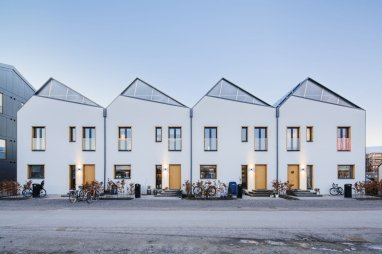 a-row-of-homes-facing-east-west-is-topped-with-a-sawtooth-roofline-each-homes-pitch-is-angled-to-catch-as-much-sun-as-possible