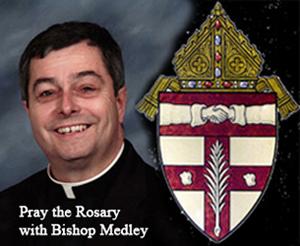 Bishop William Medley of Owensboro praying the rosary