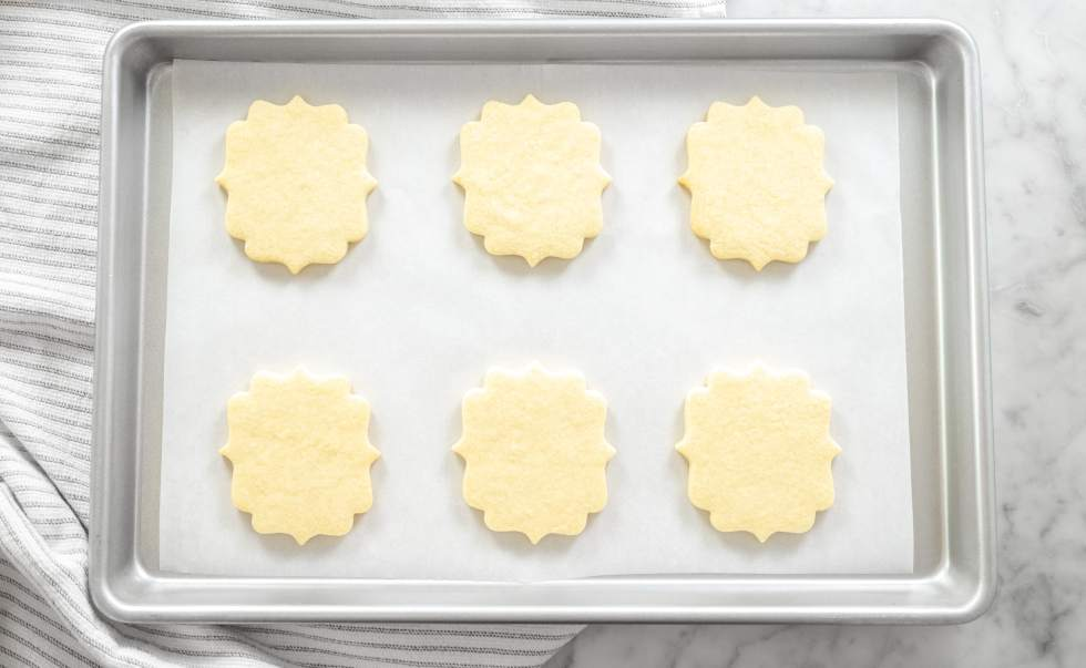 No Chill Sugar Cookie Cut Outs- on a tray with cloth