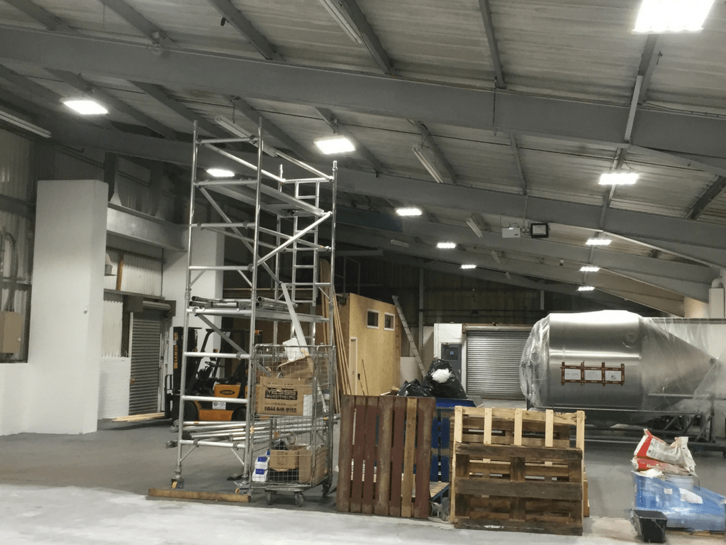 Owled's 150W Linear Bays installed in Harris Trucking's Warehouse