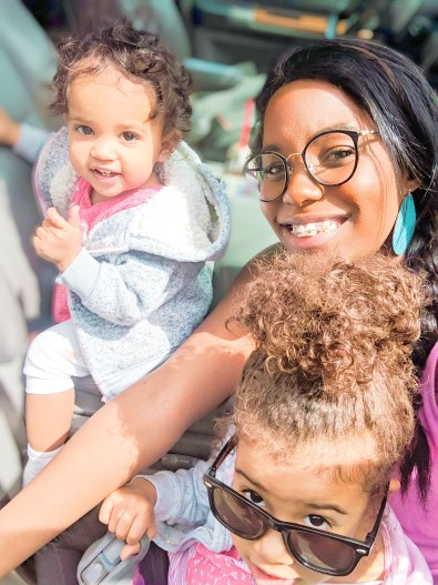 Chanelle Holder, founder and blogger at Maturing Mama taking a selfie with her two daughters.