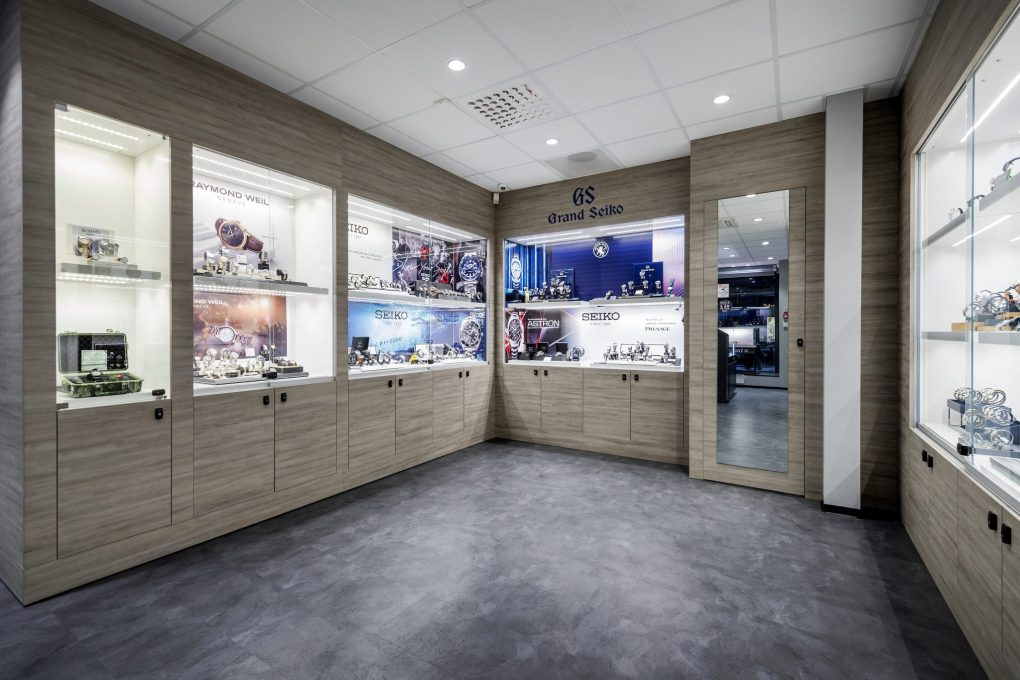 Grand Seiko and Raymond Weil watches on display in a OWUP client store