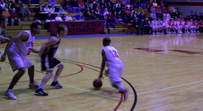 Men's basketball loses to Wooster, remains positive