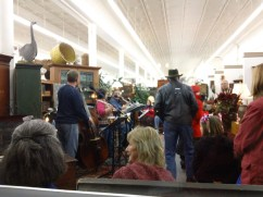 A band warms up in Delaware Antiques for a crowd munching on chocolate delights.