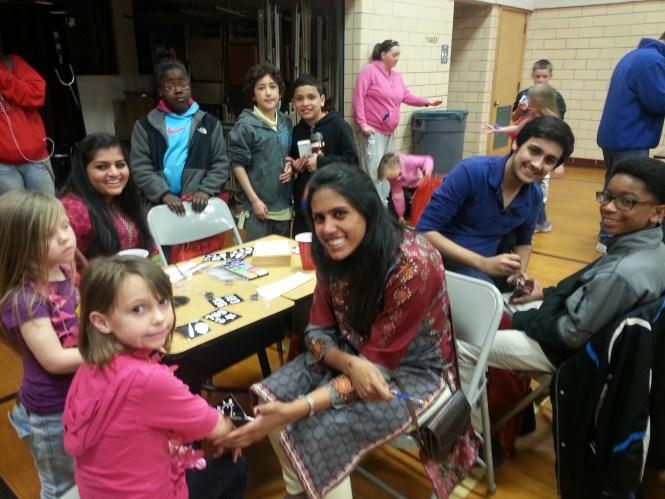 From left to right: senior Krina Patel, senior Priyanka Venkataraman and freshman Shaaref Shah. They are working with the children at Woodward Elementary School.  Photo by Jija Dutt