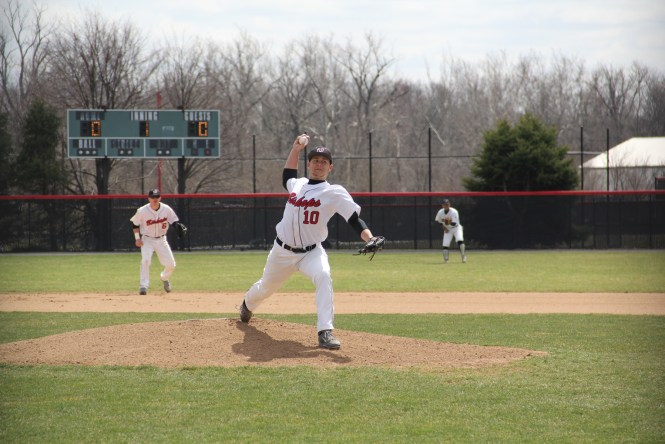 Top: Junior JJ Buckey throws a strike to make it full count against Cincinatti-Clermont at Littick Field on April 10. Photo by Jane Suttmeier