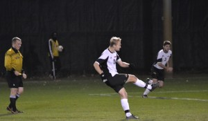 Senior Colton Bloecher fires a free-kick opportunity against Kenyon College at the Jay Martin Soccer Complex on Nov. 8. Photo by Graham Lucas