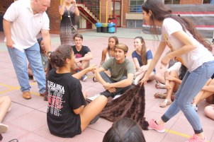 """Students learn each other's names during the """"blanket game."""""""