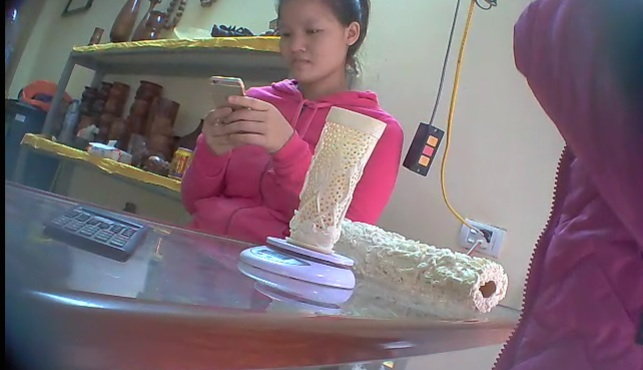 Undercover shot of a shop selling ivory carvings in Ni Khe