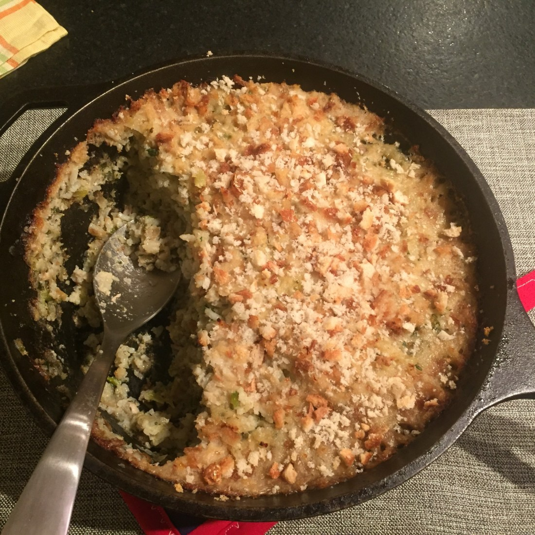 Deep skillet of oyster and rice dressing.