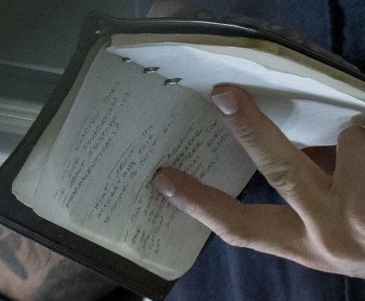 Close-up of the text written in Eddie Brock's notebook in Venom.