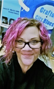 Angie with pink hair and Grafton City Blues poster