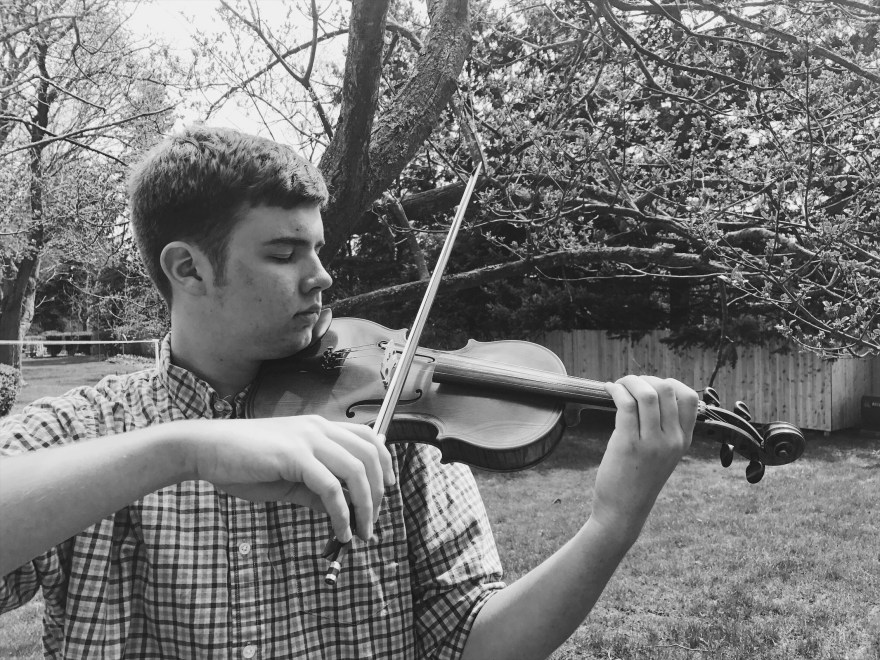 Young man playing the violin black and white photo
