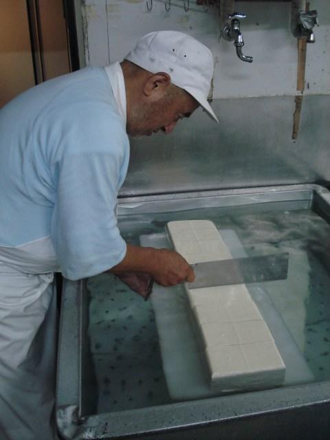 Cutting the Momen Tofu into blocks
