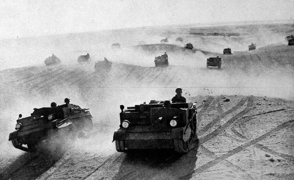In Egypt, 30,000 British & Commonwealth troops are advancing deep into the desert- ready for a surprise attack on Italian invaders. Allied forces hiding in no-man's land of the Egyptian desert; windscreens removed from vehicles so no Italian reconnaissance will spot tell-tale sun-glare