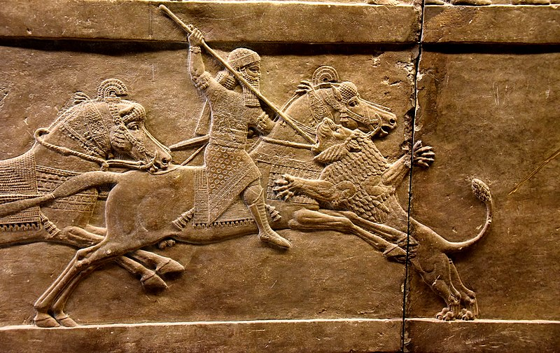 Assyrian king Ashurbanipal on his horse thrusting a spear onto a lion's head. Alabaster bas-relief from Nineveh, dating back to 645-635 BCE and is currently housed in the British Museum, London
