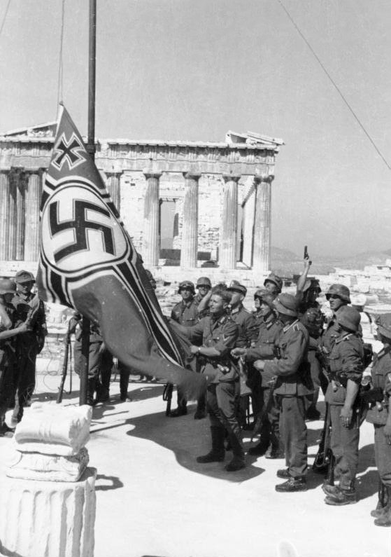 Nazi conquerors of Greece are now raising a swastika flag above the ancient Acropolis
