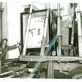 Circa 1940's Men Loading Safe on Truck