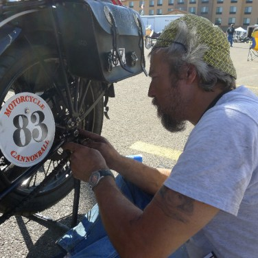Paul working on his bike during 2014 Cannonball