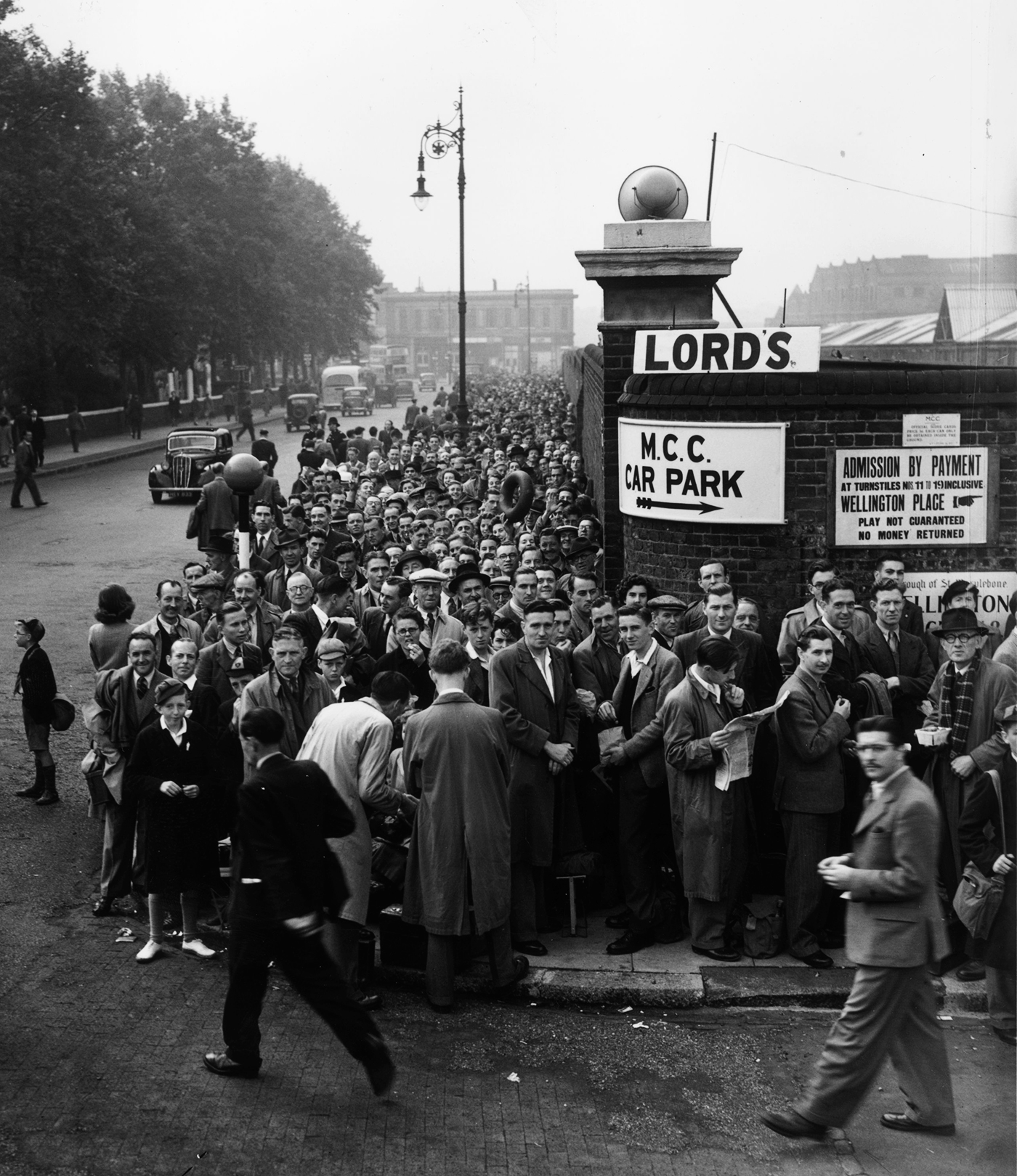 Crowds queue up outside Lord's for day two of the first Test