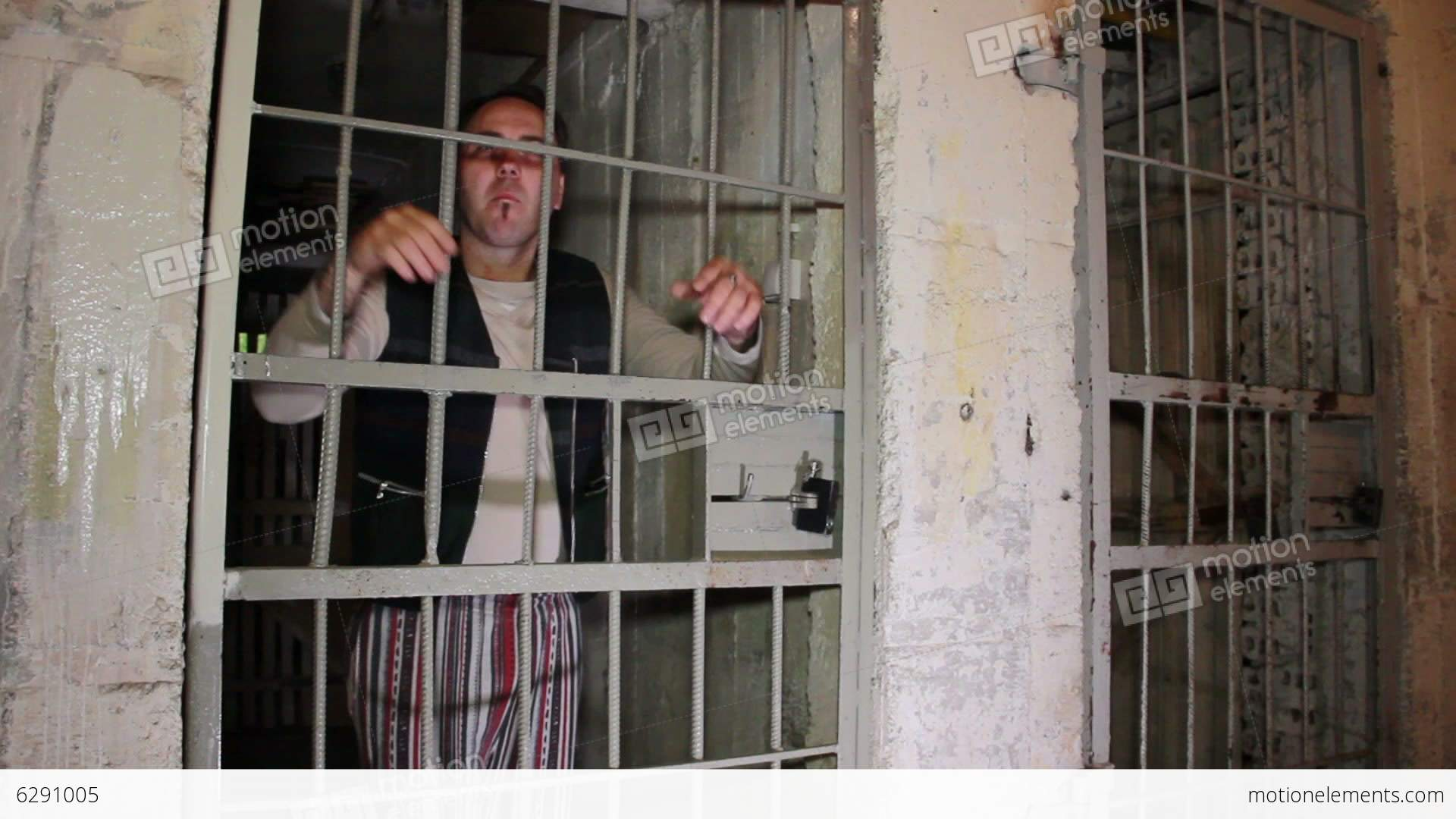 Bad Guy In A Prison Cell Shows Middle Finger Stock Video