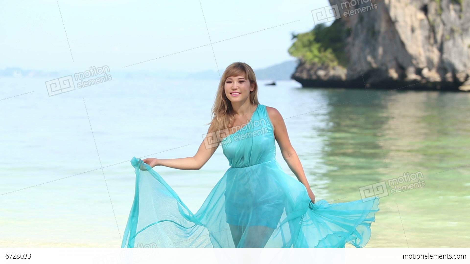 Blonde Asian Girl In Transparent Blue Dress Smiles Stock Video Footage 6728033