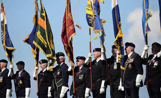 WWII veterons attend a Drumhead Service on Southsea Common in commemoration of the D-Day landings on June 5, 2014 in Portsmouth, England.