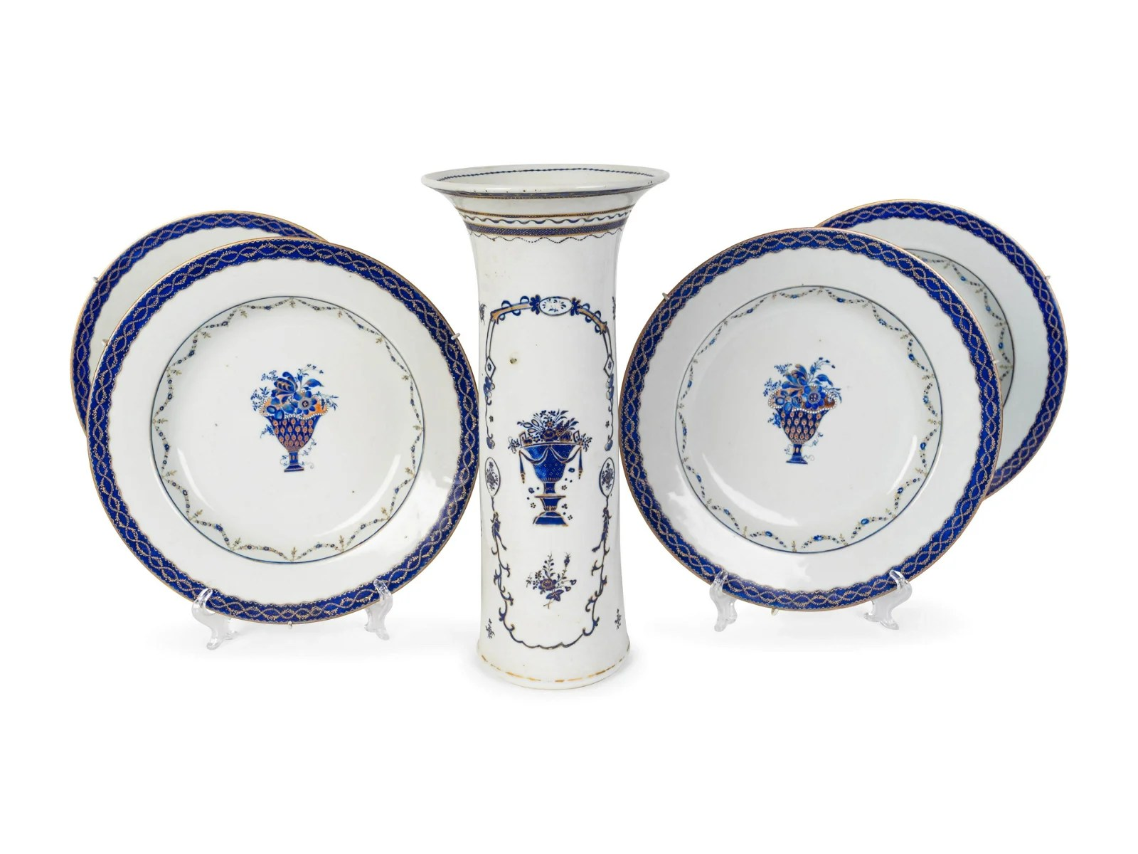 A Set of Four Chinese Export Porcelain Plates and a