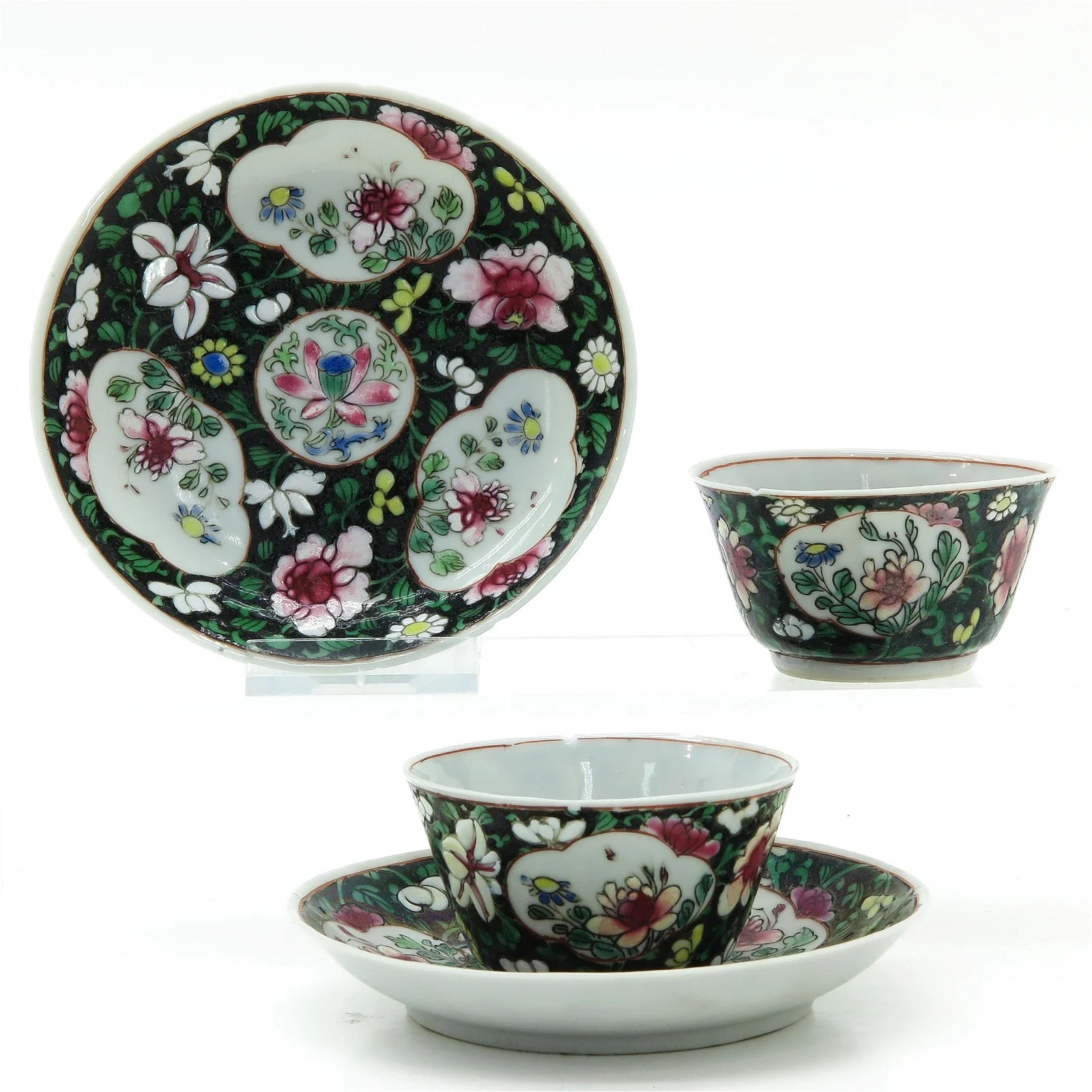 Two Chinese Famille Noir Cups and Saucers