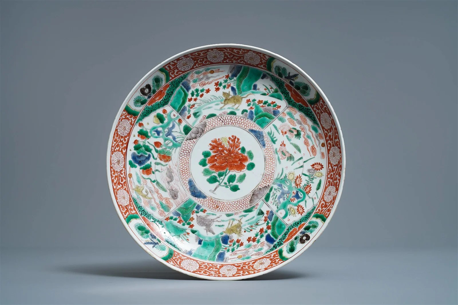 A Chinese famille verte charger with animals and