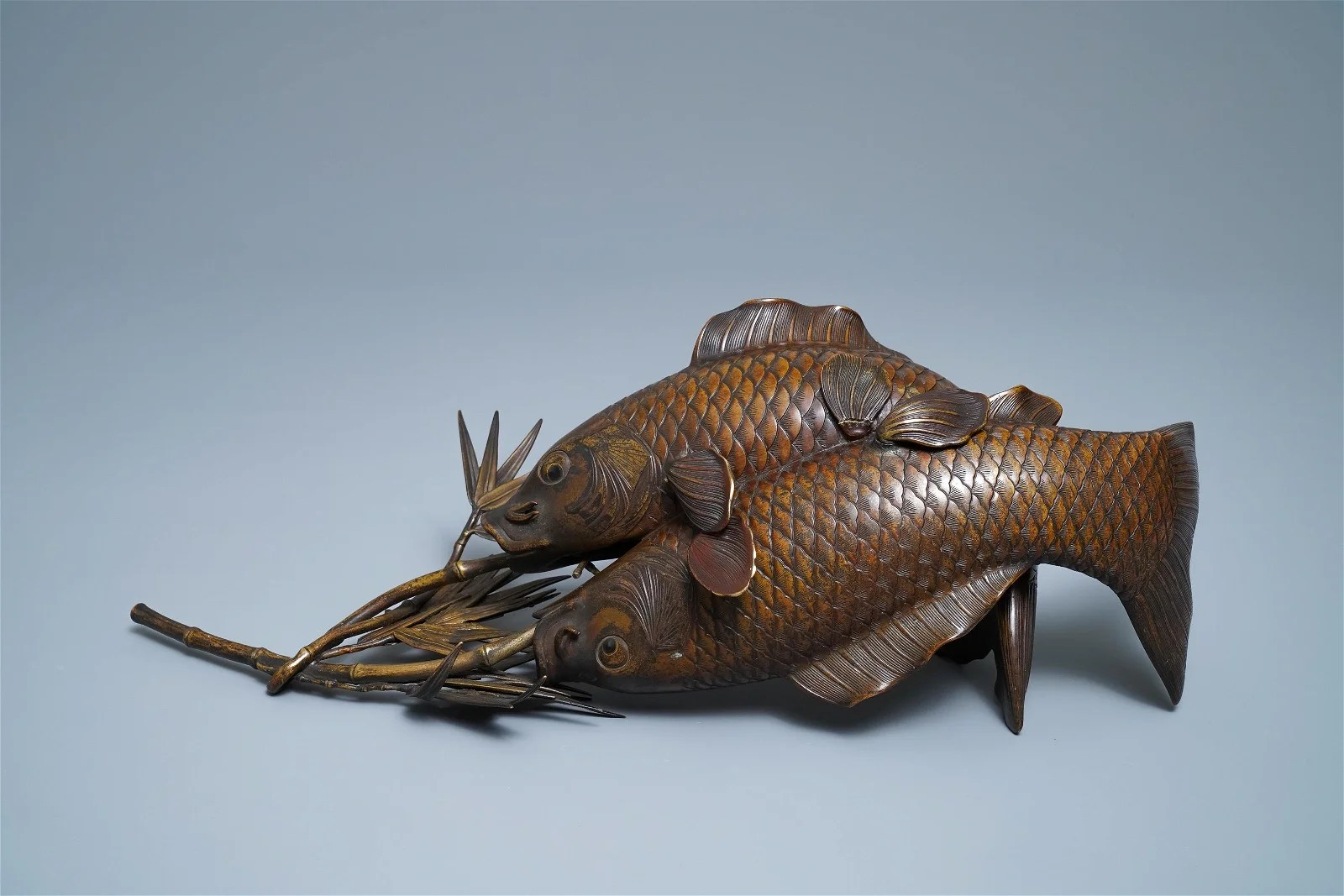 A Japanese bronze group depicting two koi fish, Meiji,
