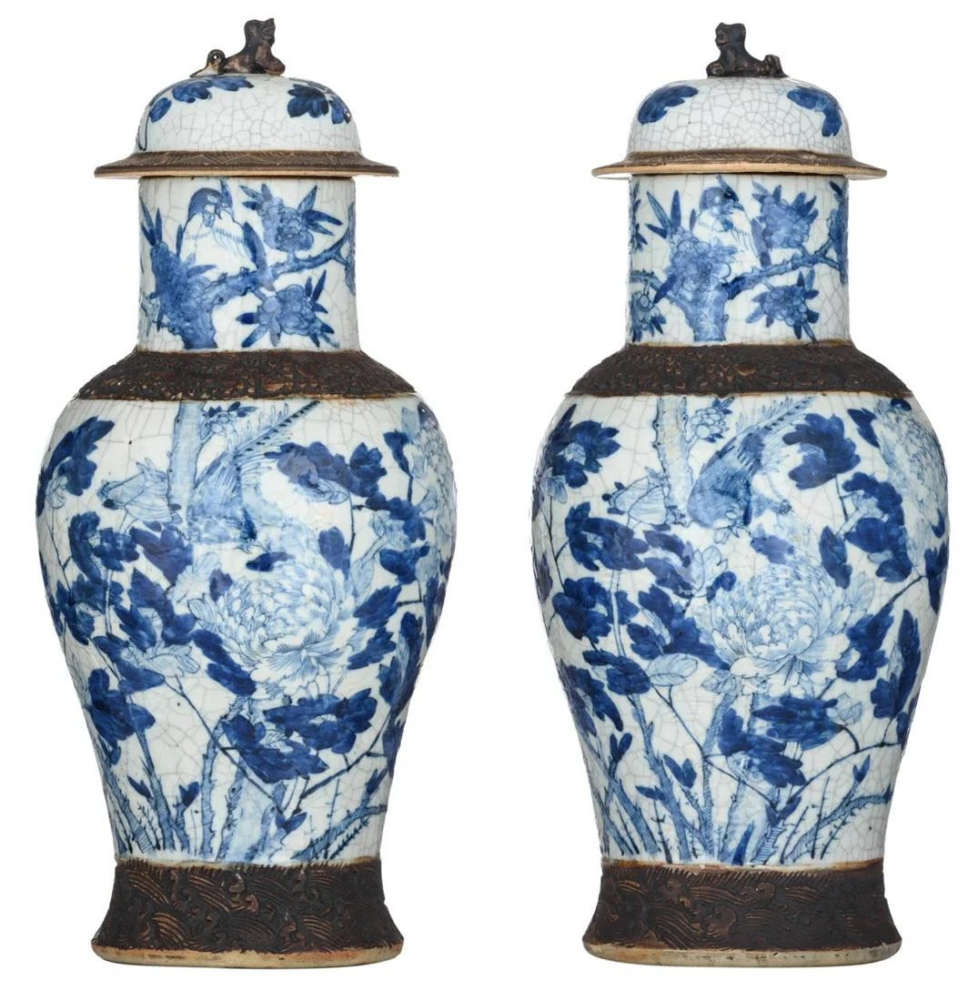 A pair of Chinese blue and white stoneware vases and