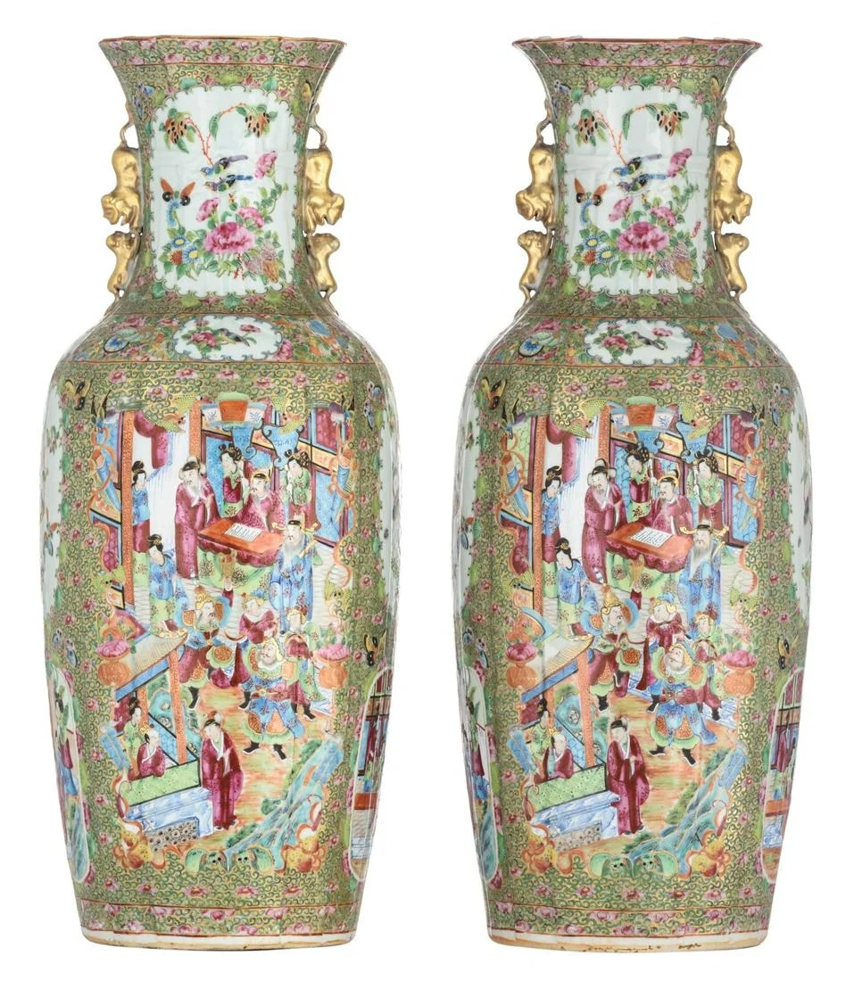 Two Chinese Canton relief vases, the roundels decorated