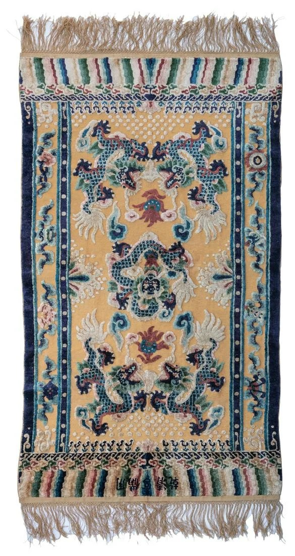 An imperial silk rug with gold thread, decorated with