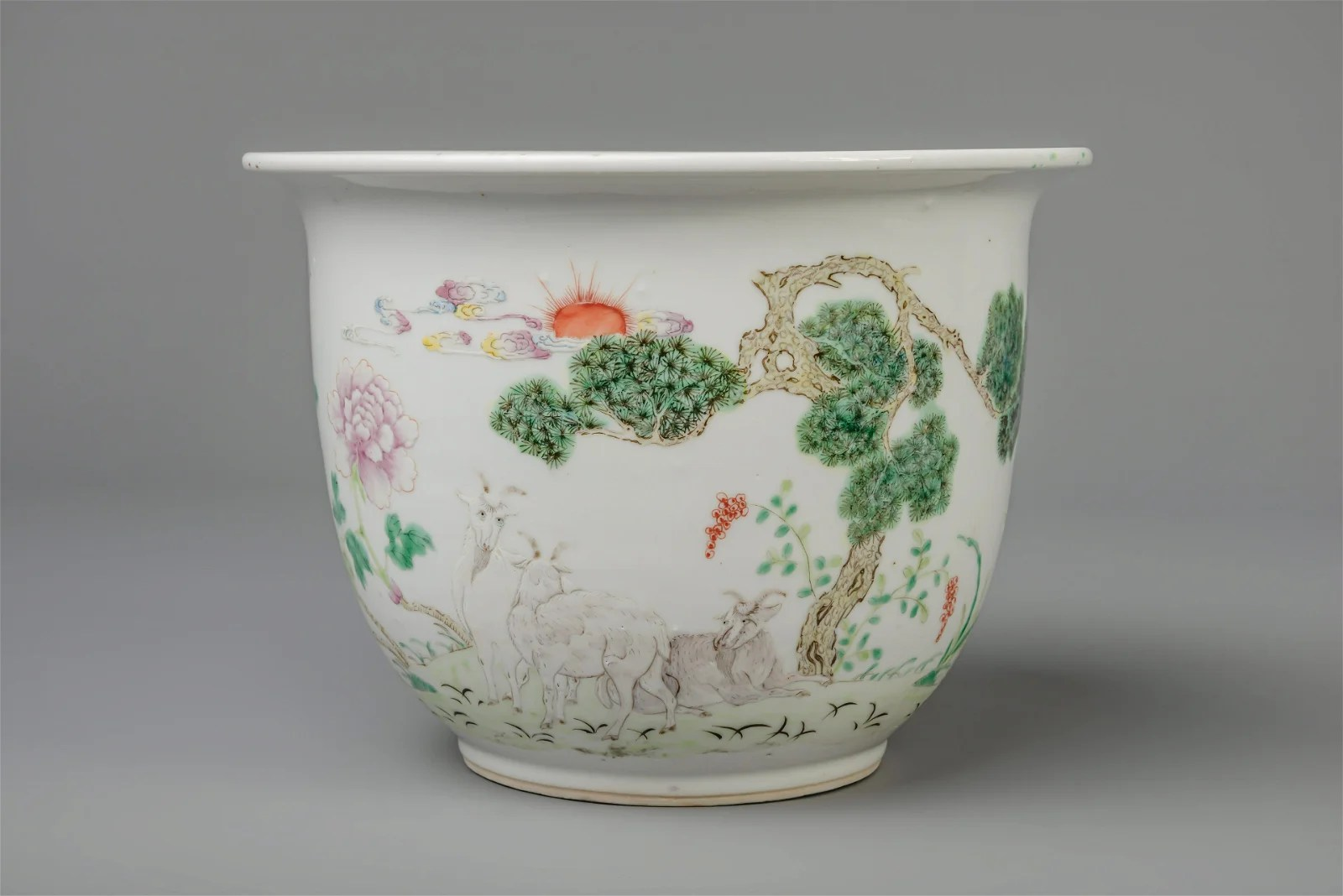 A Chinese famille rose jardinière with goats, 19th C.