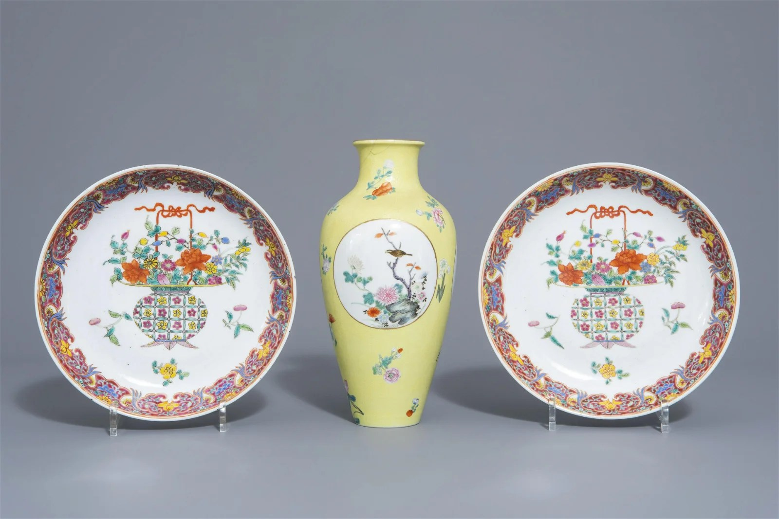 A pair of Chinese famille rose plates and a yellow
