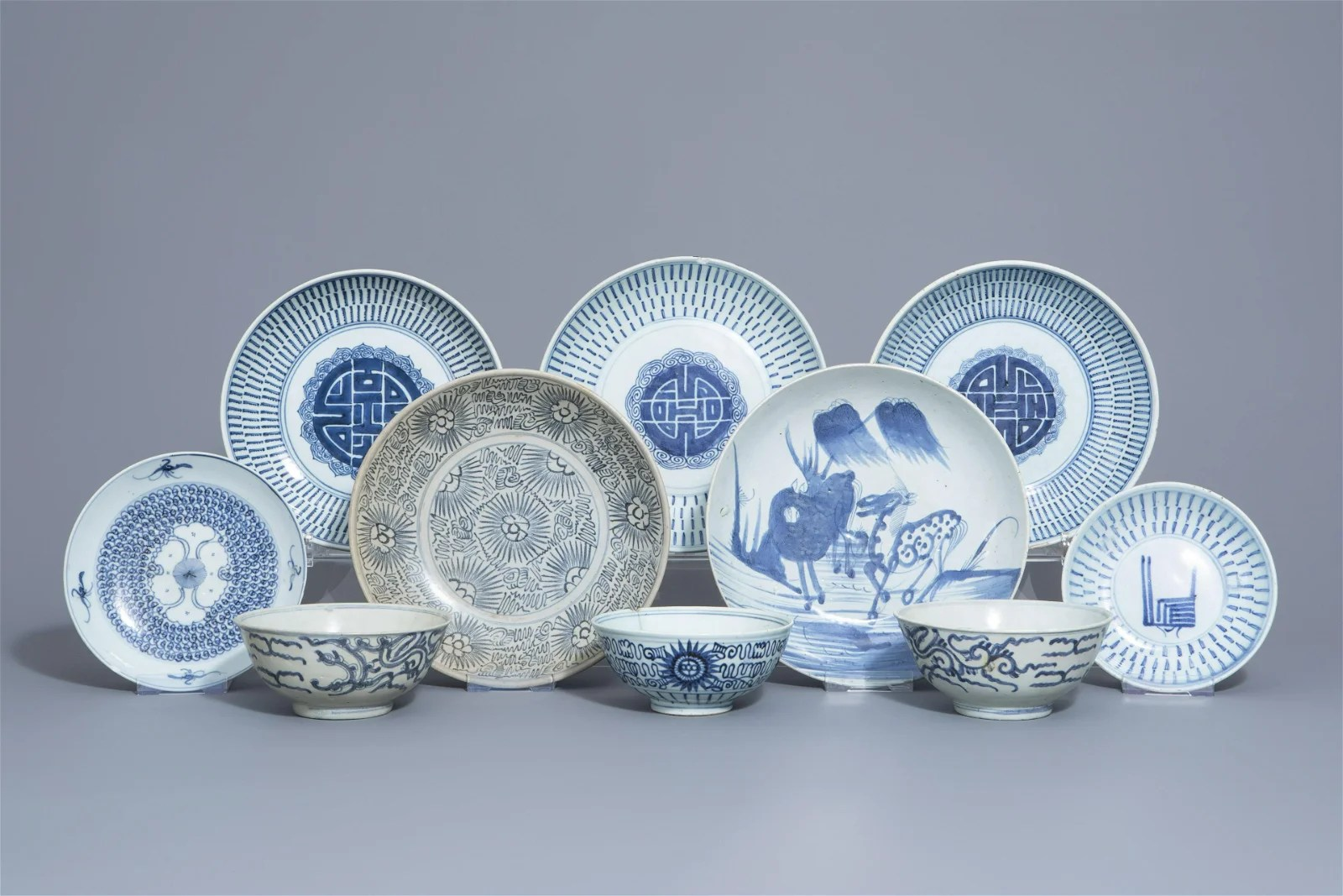 Seven Chinese blue and white plates and three bowls,