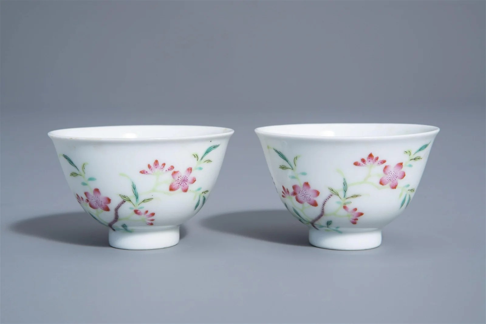 A pair of Chinese famille rose cups with floral design,