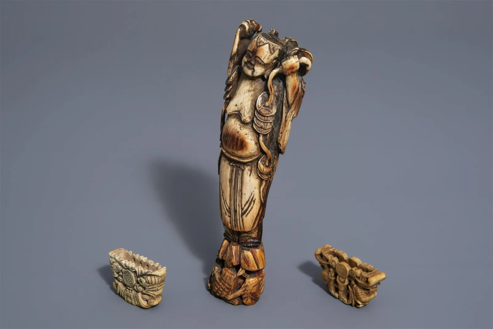 A Chinese Liu Hai figure and two fan fragments, Ming