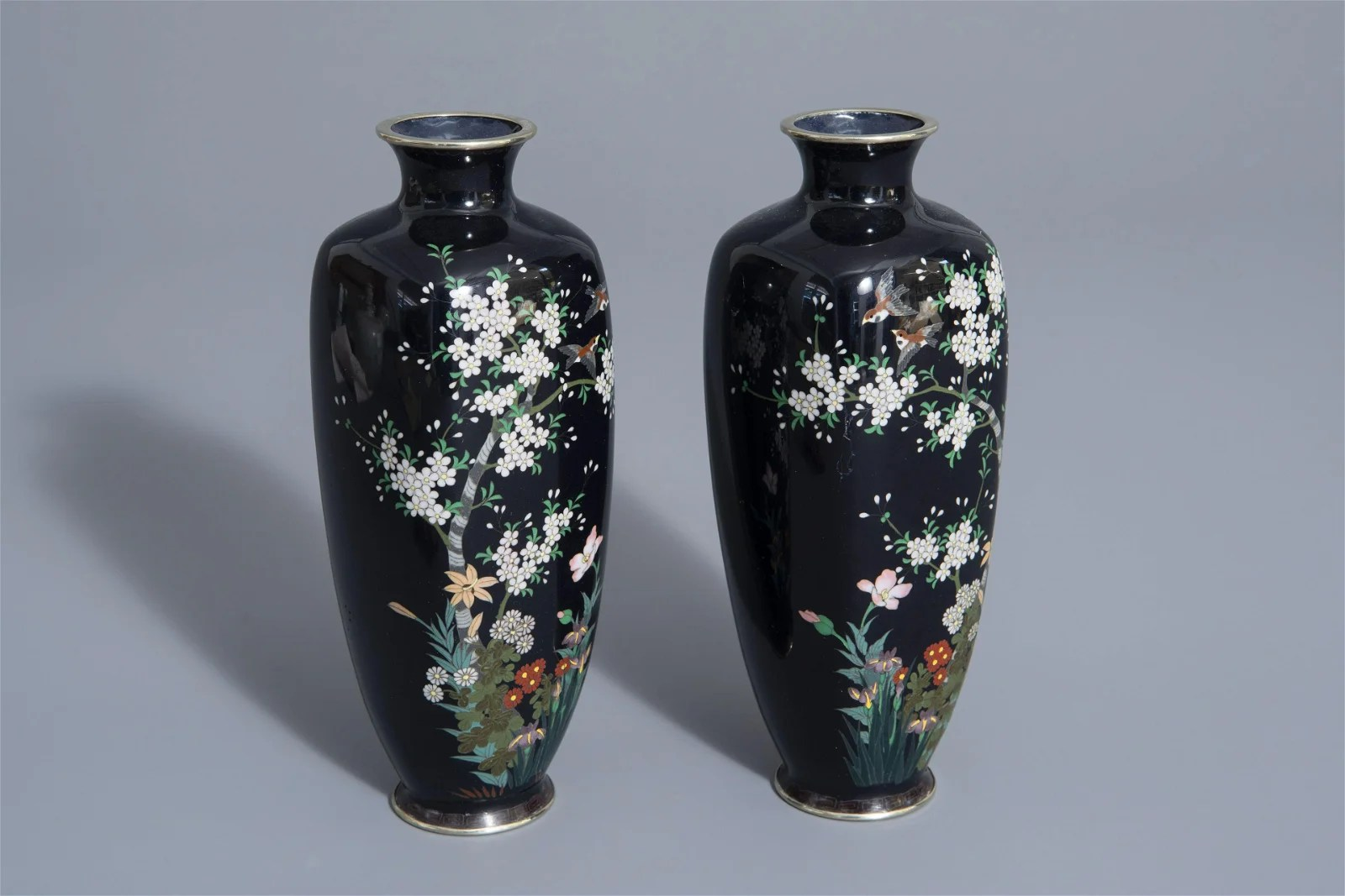 A pair of Japanese cloisonné vases with birds among