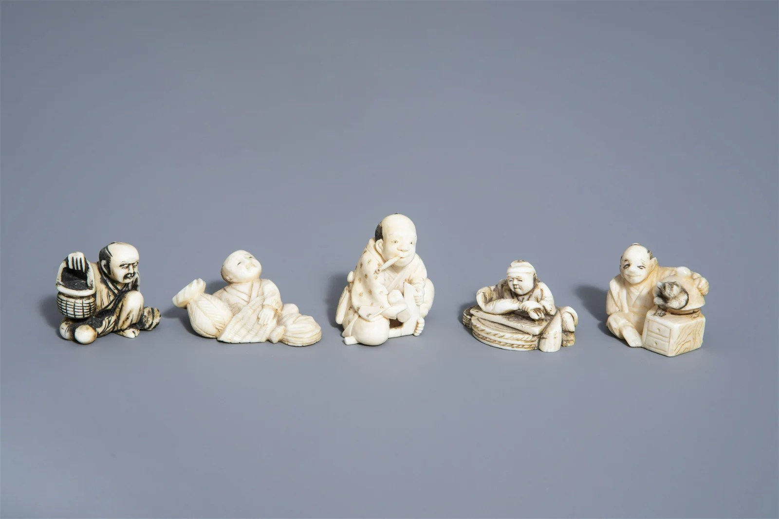 Five Japanese netsuke with scenes from daily life