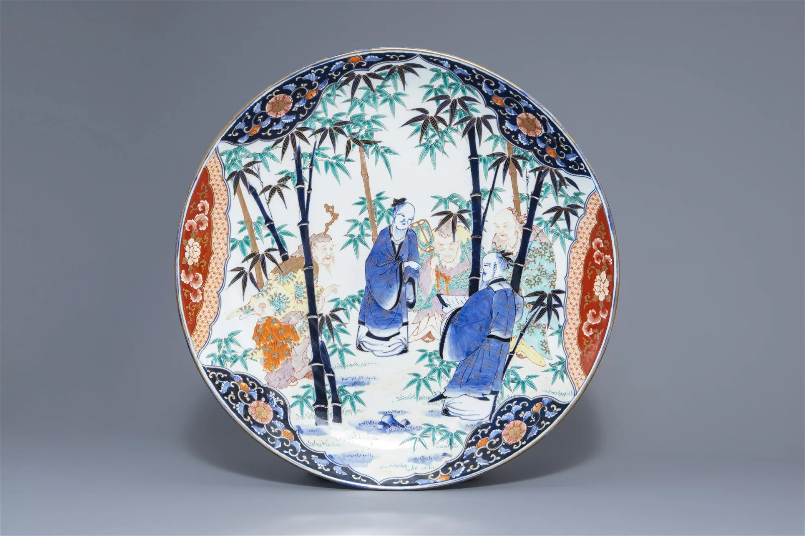 A large Japanese Imari charger with figures in a